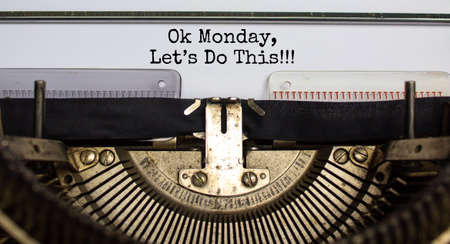 Success start monday symbol. Words 'ok monday let is do this' typed on retro typewriter. Business, motivational concept. Beautiful background.