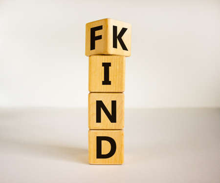 Find your kind symbol. Turned cubes with words find kind. Beautiful white table, white background, copy space. Business, motivational and find your kind concept.