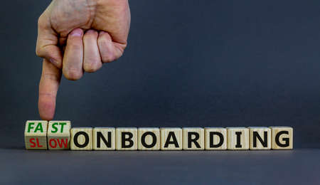 Fast or slow onboarding symbol. Businessman turns cubes and changes words 'slow onboarding' to 'fast onboarding'. Beautiful gray background, copy space. Business and fast or slow onboarding concept.