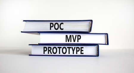 POC, MVP or prototype symbol. Books with words POC, proof of concept, MVP, minimum viable product and prototype. Beautiful white background. Business and POC, MVP or prototype concept, copy space.