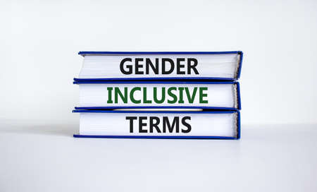 Gender inclusive terms symbol. Books with words 'Gender inclusive terms' on beautiful white table, white background. Business and gender inclusive terms concept. Copy space. Stock fotó