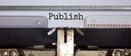 Publish symbol. The word 'publish' typed on retro typewriter. Business, publish concept. Beautiful background. 스톡 콘텐츠 - 165321648