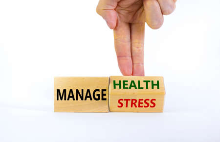 Manage stress and be health symbol. Doctor turns a cube and changes words 'manage stress' to 'manage health'. Beautiful white background. Psychological, business and manage stress concept. Copy space.