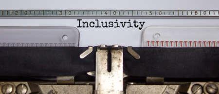 Inclusivity and belonging symbol. The word 'inclusivity' typed on retro typewriter. Business, inclusivity and belonging concept. Beautiful background.