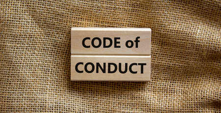 Code of conduct symbol. Concept words 'Code of conduct' on wooden blocks on a beautiful canvas background. Business and code of conduct concept. Copy space.