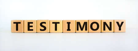 Testimony symbol. Wooden cubes with the word 'testimony'. Beautiful white background. Business, testimony concept. Copy space.