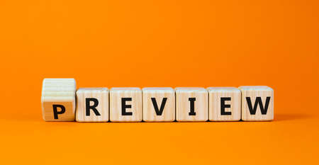 Preview or review symbol. Turned the cube and changed the word 'preview' to 'review'. Beautiful orange background, copy space. Business, preview or review concept.