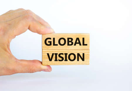 Global vision symbol. Wooden blocks with words 'Global vision' on beautiful white background. Businessman hand. Business and global vision concept. Copy space.