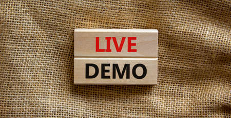 Live demo symbol. Concept words 'live demo' on wooden blocks on a beautiful canvas background. Copy space. Business and live demo concept. Stock Photo