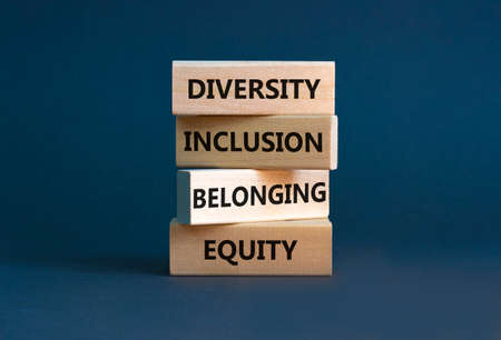 Equity, diversity, inclusion and belonging symbol. Wooden blocks with words 'equity, diversity, inclusion, belonging' on beautiful gray background. Diversity, equity, inclusion and belonging concept.
