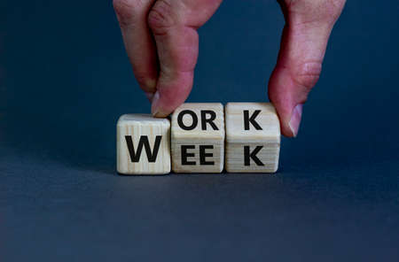 Work week symbol. Businessman turns wooden cubes with words 'Work week'. Beautiful gray background. Work week and business concept. Copy space.