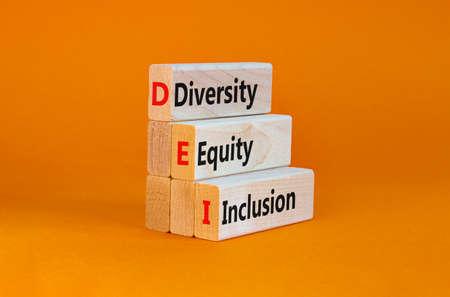 DEI, Diversity, equity, inclusion symbol. Wooden blocks with words DEI, diversity, equity, inclusion on beautiful orange background. Business, DEI, diversity, equity, inclusion concept.