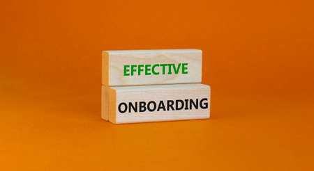 Effective onboarding symbol. Wooden blocks with words Effective onboarding on beautiful orange background. Business, HR and effective onboarding concept. Copy space.