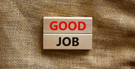Good job symbol. Concept words 'good job' on wooden blocks on a beautiful canvas background. Business and good job concept, copy space.