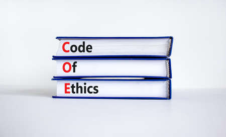 COE, Code of ethics symbol. Concept words 'COE, Code of ethics' on books on a beautiful white background. Business and COE, code of ethics concept. Copy space.