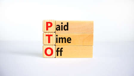 PTO, Paid time off symbol. Wooden blocks with concept words 'PTO, Paid time off'. Beautiful white background, copy space. Business and PTO, paid time off concept. 스톡 콘텐츠