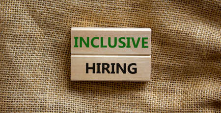 Inclusive hiring symbol. Wooden blocks with words Inclusive hiring on beautiful canvas background. Business, HR and inclusive hiring concept. Copy space.