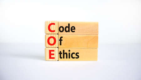 COE, Code of ethics symbol. Concept words 'COE, Code of ethics' on wooden blocks on a beautiful white background. Business and COE, code of ethics concept. Copy space.