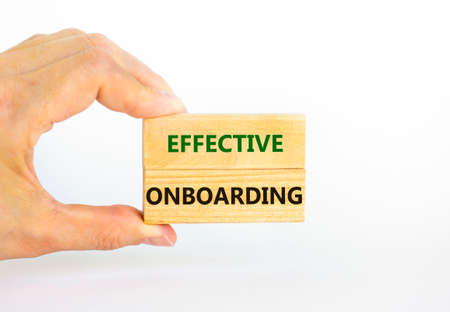 Effective onboarding symbol. Wooden blocks with words Effective onboarding on beautiful white background. Businessman hand. Business, HR and effective onboarding concept. Copy space. 스톡 콘텐츠