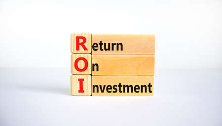 ROI, Return on investment symbol. Wooden blocks with words 'ROI, Return on investment'. Beautiful white background, copy space. Business and ROI, return on investment concept.
