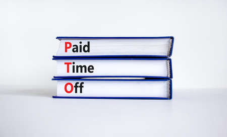 PTO, Paid time off symbol. Books with concept words 'PTO, Paid time off'. Beautiful white background, copy space. Business and PTO, paid time off concept. 스톡 콘텐츠
