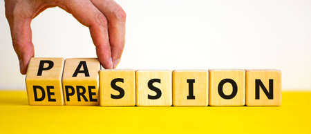 Passion or profession symbol. Businessman turns wooden cubes and changes the word profession to passion. Beautiful yellow table, white background, copy space. Business, passion or profession concept. 스톡 콘텐츠