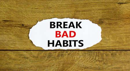 Break bad habits symbol. Words 'Break bad habits' on white paper. Beautiful wooden background. Business, psychology and break bad habits concept. Copy space.