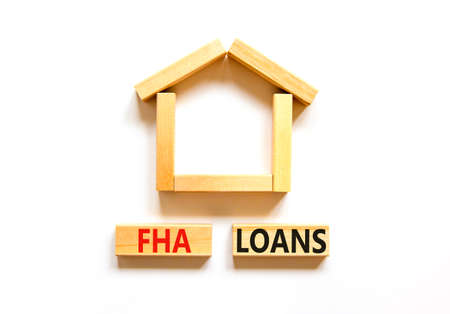 FHA federal housing administration loans symbol. Concept words 'FHA federal housing administration loans' on wooden blocks on a beautiful white background. Business and FHA loans concept. Copy space.