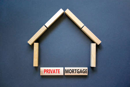 Private mortgage symbol. Concept words 'Private mortgage' on wooden blocks near miniature wooden house. Beautiful grey background. Business, private mortgage concept.