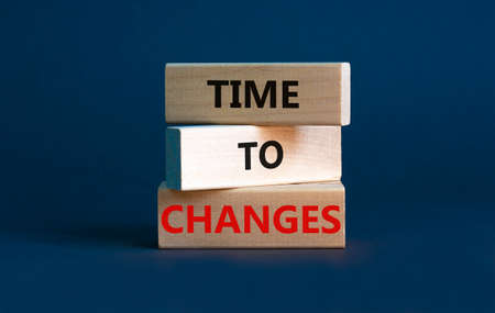 Time to changes symbol. Concept words 'Time to changes' on wooden blocks. Beautiful grey background. Business and time to changes concept. Copy space.
