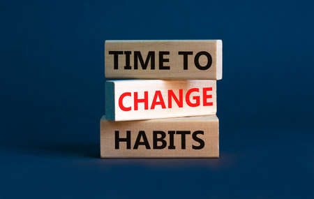 Time to change habits symbol. Concept words 'time to change habits' on wooden blocks. Beautiful grey background. Copy space. Business and time to change habits concept.