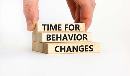 Time for behavior changes symbol. Concept words 'Time for behavior changes' on wooden blocks. Businessman hand. Beautiful white background. Business and time to behavior changes concept. Copy space. Stock Photo