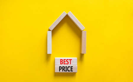 Best price and house symbol. Concept words 'best price' on wooden blocks near miniature house. Beautiful yellow background, copy space. Business and best price house concept.