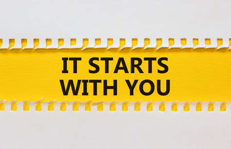 It starts with you symbol. Yellow and white sheet of paper. Concept words 'it starts with you'. Beautiful yellow background. Business starts with you concept, copy space.