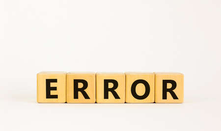 Error symbol. The concept word 'error' on wooden cubes on a beautiful white table, white background. Business and error concept. Copy space.