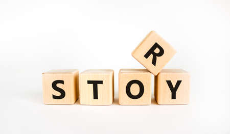 Story and storytelling symbol. The concept word 'story' on wooden cubes. Beautiful white table, white background. Business story and storytelling concept. Copy space.
