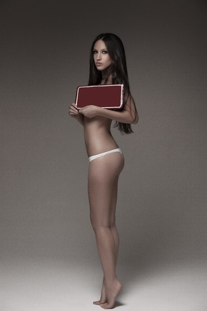 sexy woman holding empty red board wearing white underwear photo