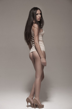 nude pose: Sexy beautiful woman with long lags posing in studio. Body care anticellulite concept.