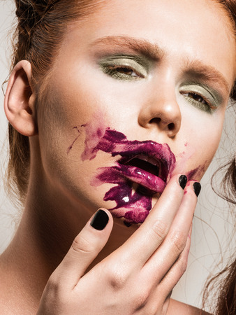 lipgloss: Young woman with ruined makeup. Trendy purple lipgloss. Stock Photo