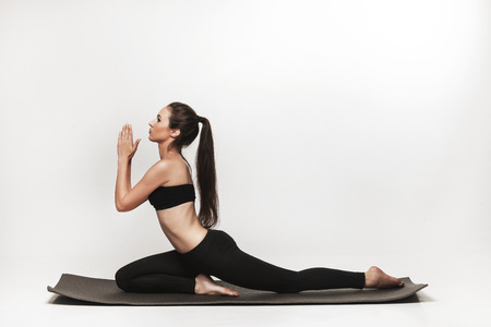 pony tail: Young fit woman at yoga class. Attractive brunette woman with pony tail practicing yoga. Healthy lifestyle and sports concept. Series of exercise poses. Isolated on white.