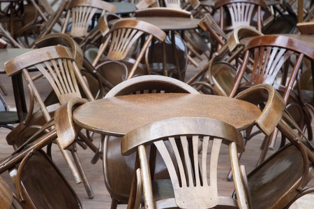chaotically: Chaotically spaced tables and chairs Stock Photo