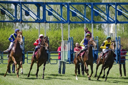 LVIV, UKRAINE - APRIL 28, 2012: Opening the season at Lviv hippodrome. In the photo - participants race.