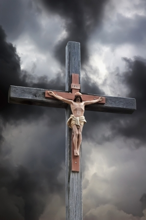 Crucifixion of Jesus Christ against the backdrop of dramatic clouds