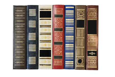 Old books in a row. Isolated over white. photo