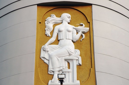 alchemical: LVIV, UKRAINE - MARCH 13: The bas-relief above the entrance to the old pharmacy - the girl with the symbol of medicine on March 13, 2011 in Lviv, Ukraine. Author - R.E. Olensk, 1980.