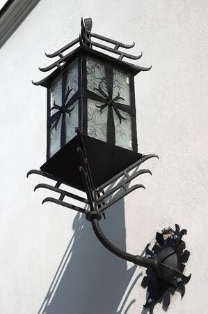 Wrought-iron street lamps on the building in Lvov, Ukraine photo