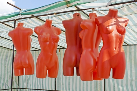 without clothes: Torsos mannequins without clothes hanging on the counter