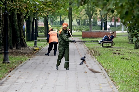 GOMEL, BELARUS - AUGUST 27: The advantage of Belarus is the cleanliness on the streets and in the parks on August 27, 2012 in Gomel, Belarus. In photo - Janitors sweep the sidewalks in the park.