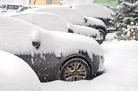 Cityscape - parked cars covered with snow photo