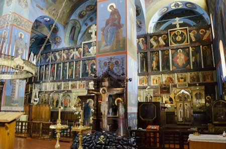 Interior of the Trinity cathedral in Pochaev Lavra (Pochayiv) near lvov, Ukraine. Crucifix, Virgin, icons of the saints on the altar